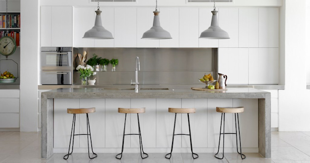 modern kitchen with four stools
