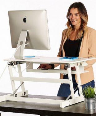 women working on a standing desk