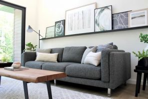 grey sofa bed for living room with wood table and art on the wall