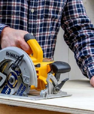 close up picture of working with cordless power saw