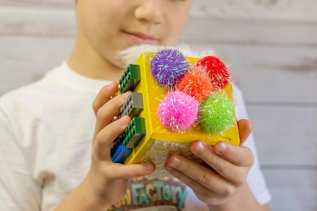 Close-up of playing with sensory toy