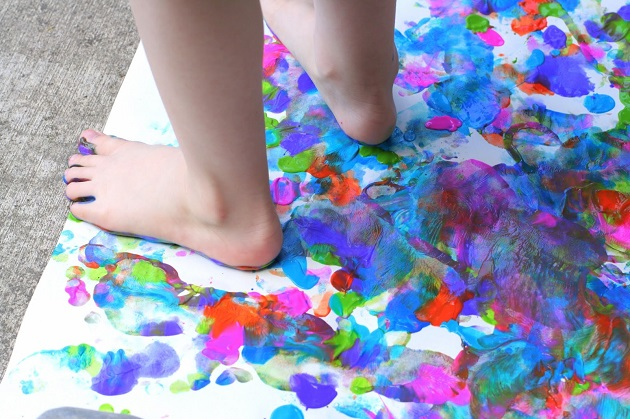 Kid painting with foot