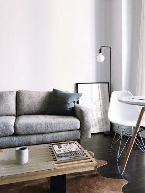 grey sofa bed for living room with large wood coffee table