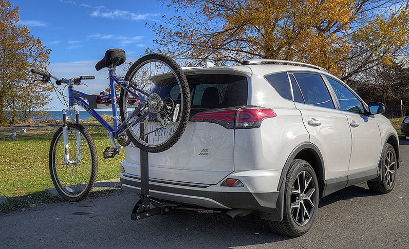 rear mounted rack carrying a bicycle