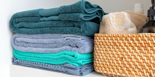 bath towels and basket for towel and bathroom essentials