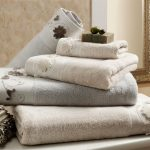 white bath towels with some details