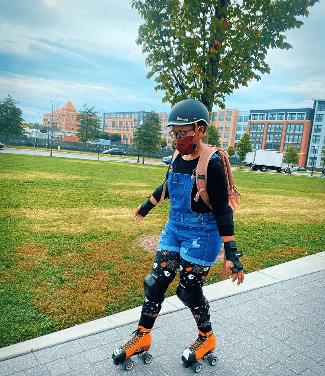 picture of a girl in roller skating on the sidewalk