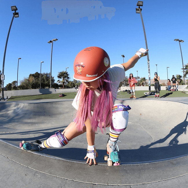 picture of a girl riding roller skates on a park